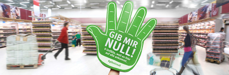 Banner zeigt grüne Hand GMN im Supermarkt