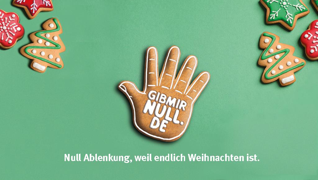 """Eine Lebkuchen-Hand mit """"Gibmirnull.de"""" und Unterschrift: Null Ablenkung, weil endlich Weihnachten ist."""