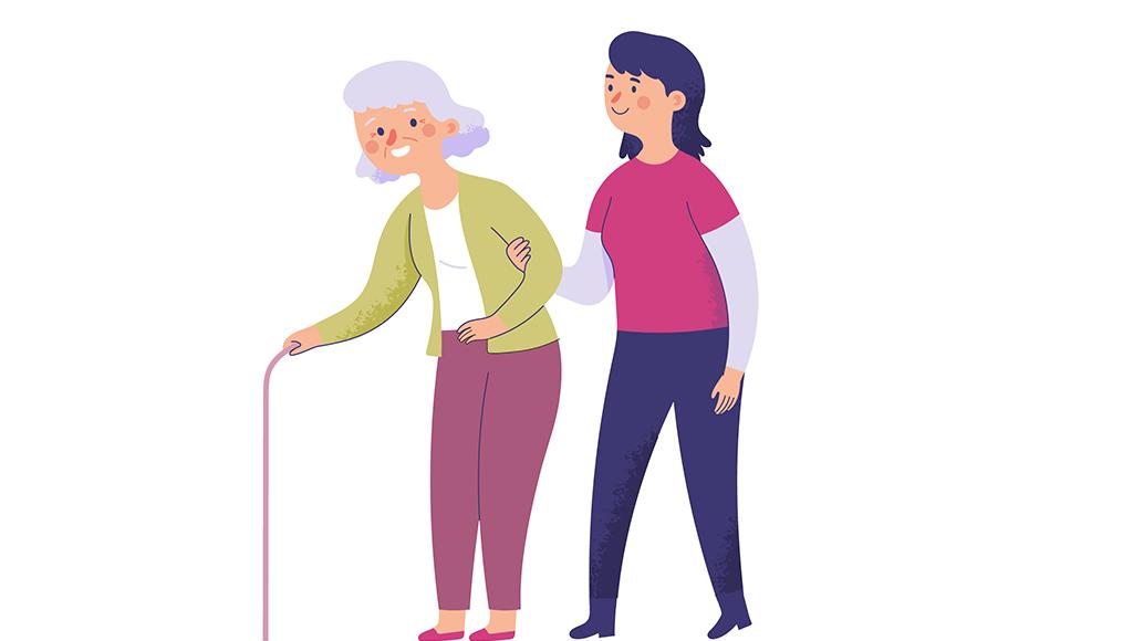 Eine jüngere Frau hilft einer älteren Frau mit Gehstock.
