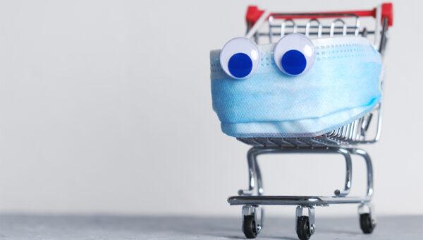 Fotomontage: Einkaufswagen mit Maske.